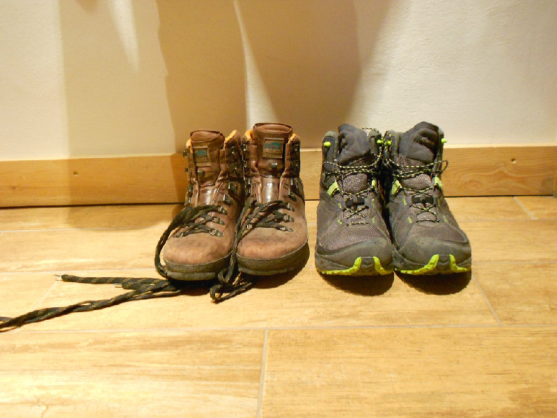 two pairs of hiking boots